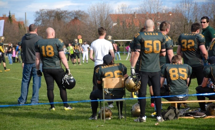 We won our first game last week 36-6.  I am on the left in the gray sweatshirt.