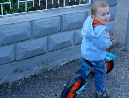 Jackson's all smiles trying to learn the bike